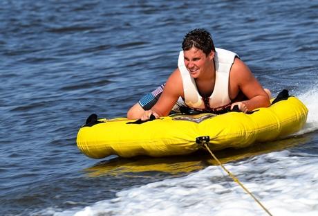 man tubing on water