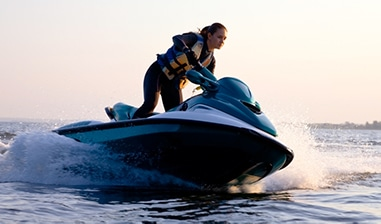girl riding jet ski with wet suit on
