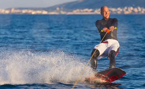 wakeboarding behind a jet ski
