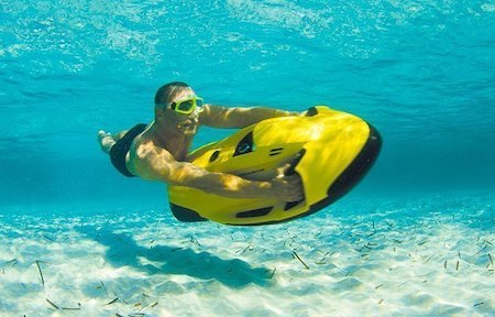 man using underwater jet ski