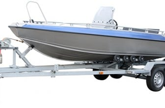 Motorized boat trailer with boat